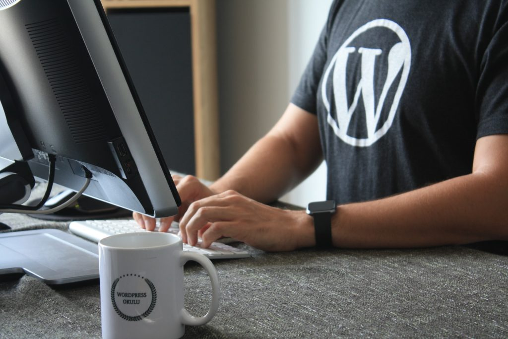 Man sitting at computer with WordPress T-shirt